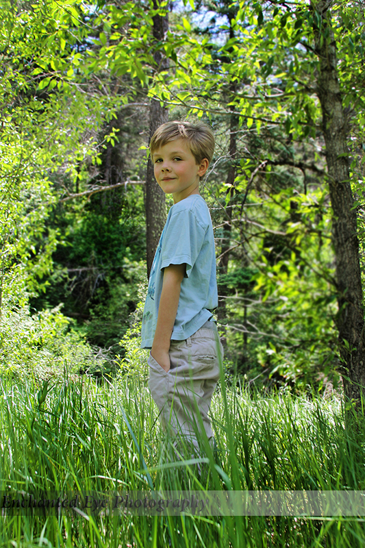 Young boy in New Mexico forest.
