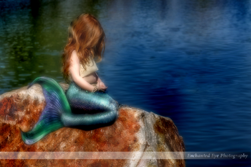 Young little mermaid with red hair.