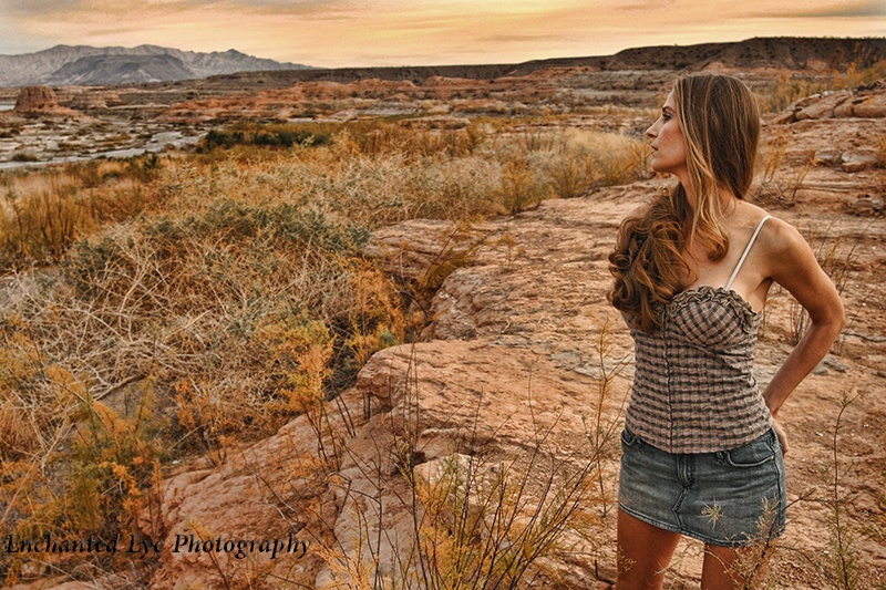 Young woman with very long light brown hair out at lake mead vista.